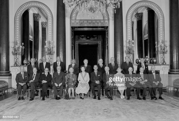 The Queen with members of the Order of Merit at Buckingham Palace Standing from lr Sir Andrew Huxley the Rev Professor Owen Chadwick Graham Greene Dr...