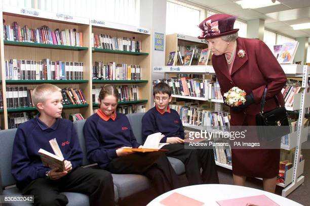 The Queen with students during her visit to the Special Educational Needs Unit and Learning Resource Centre at Smithdon High School in Hunstanton...