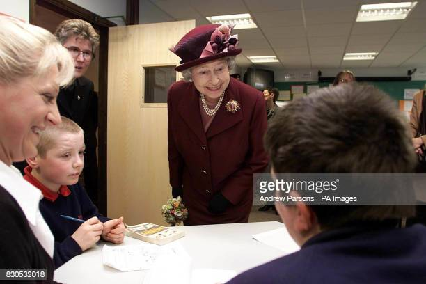 The Queen with students in the Curriculum Learning support classroom during her visit to the Special Educational Needs Unit and Learning Resource...