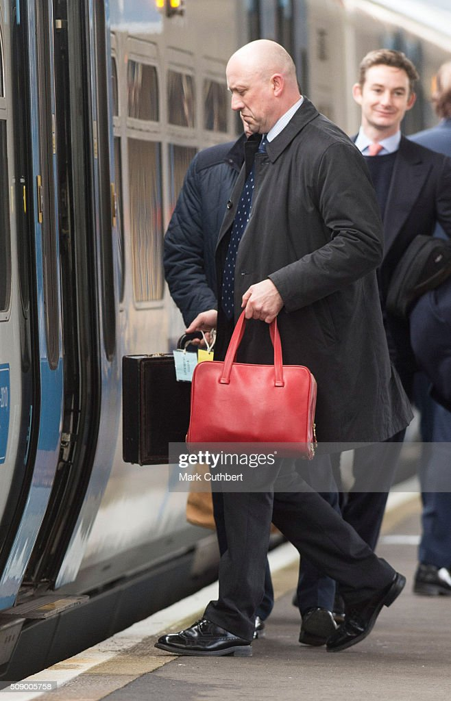 The Queens bags are carried on as Queen Elizabeth lI takes a train back to London after her Christmas break in Sandringham at King's Lynn Station on February 8, 2016 in King's Lynn, England.