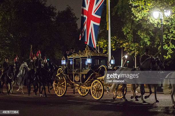 The Queens Carriage along with Guard of Honour comprising 96 rank and file and three officers from 1st Battalion Grenadier Guards with The Queen's...