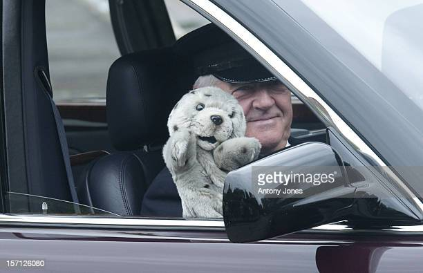 The Queens Chauffeur Waves To The Crowed With A Hand Puppet On His Way To Ascot Racecourse Friday 17Th June 2011
