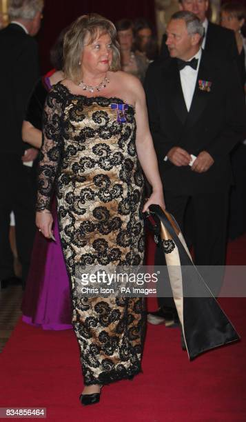 The Queen's Dresser Angela Kelly arrives for a state banquet at the Philharmonic Hall in central Bravislava Slovakia on the first of a two day state...