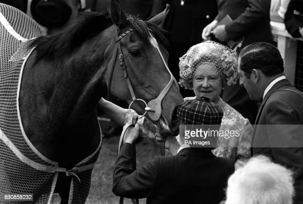 The Queen's filly Dunfermline gets a 'well done' pat from the Queen Mother in the unsaddling enclosure after winning the Jubilee Oaks at Epsom Right...
