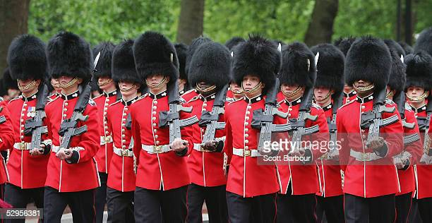 The Queen's Foot Guards march during training for the Trooping of the Colours ceremony on May 20 2005 in London England Every year on the second...