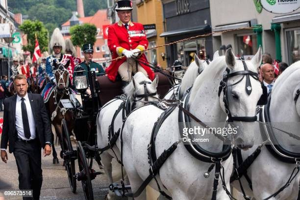 The Queens Horse Guard rides in front of the Royal coach at the main street during Queen Margrethe of Denmark's visit on June 15 2017 in Hobro...