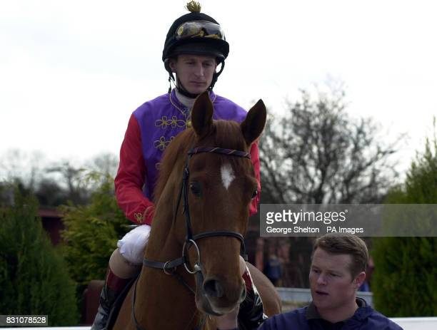 The Queen's horse Snow Bunting ridden by jockey Steve Drowne leaves the parade ring ahead of the Tips Online from Insideracingcouk Maiden Stakes...