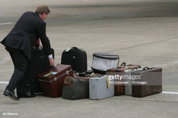 The Queens luggage on the tarmac at Heathrow Airport after her trip to the US