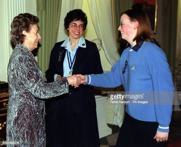 The Queen's sister Princess Margaret as President of the Guides Association greets Girl Guide Kathrine Houghton at Kensington Palace London HRH...