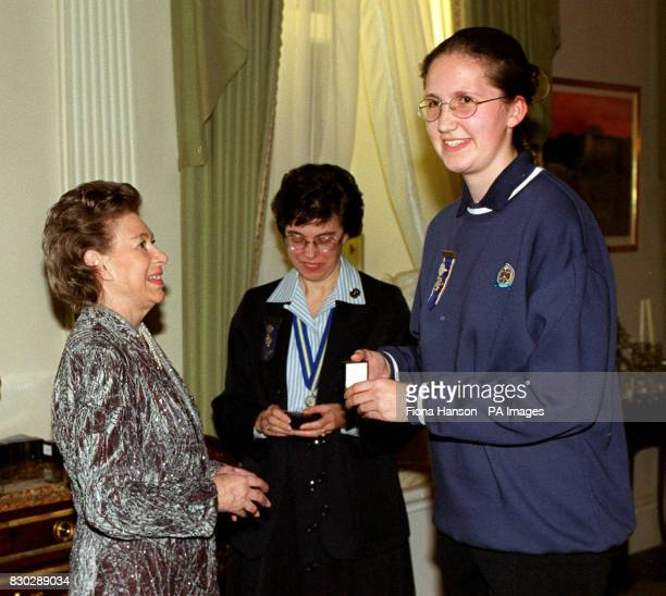 The Queen's sister Princess Margaret as President of the Guides Association greets Girl Guide Becky South at Kensington Palace London HRH presented a...