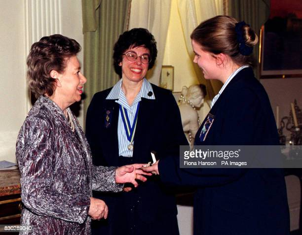 The Queen's sister Princess Margaret as President of the Guides Association greets Girl Guide Victoria Wigmore at Kensington Palace London HRH...