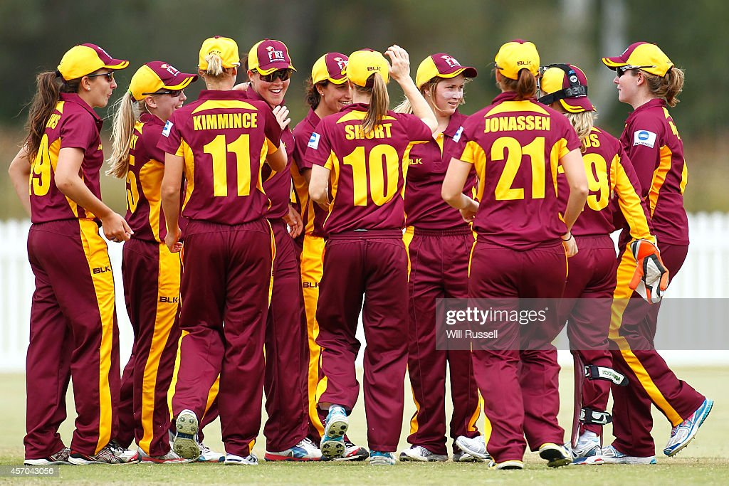The Queensland Fire celebrate after taking the wicket of Melissa Holmes of The Western Fury during the WNCL match between Western Australia and...
