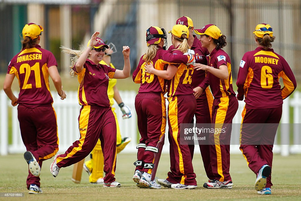 The Queensland Fire celebrate after the runout Jenny Wallace of the Western Fury during the WNCL match between Western Australia and Queensland at...
