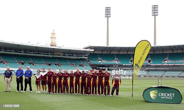 The Queensland team line up for the national anthem before the start of play at the WNCL Final match between the NSW Breakers and the Queensland Fire...