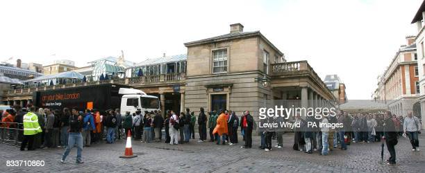 The queue in Covent Garden London where hundreds of Orange mountain bikes were given away to celebrate the 2007 Tour De France which starts later...