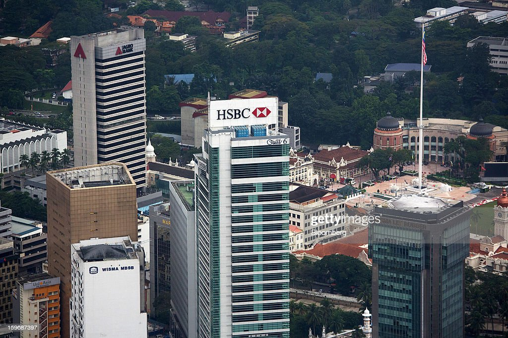 The Quill 6 building, center, which houses the new headquarters of HSBC Bank Malaysia Bhd., stands in the central business district in Kuala Lumpur, Malaysia, on Wednesday, Jan. 16, 2013. While many developed countries have faltered, Malaysia's gross domestic product growth has exceeded 5 percent for five quarters with domestic demand countering a slowdown in exports. Photographer: Lam Yik Fei/Bloomberg via Getty Images
