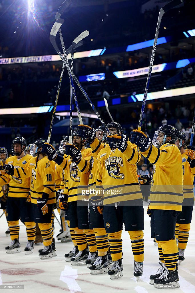 The Quinnipiac Bobcats celebrate the win over the Boston College Eagles during semifinals of the 2016 NCAA Division I Men's Hockey Championships at Amalie Arena on April 7, 2016 in Tampa, Florida.