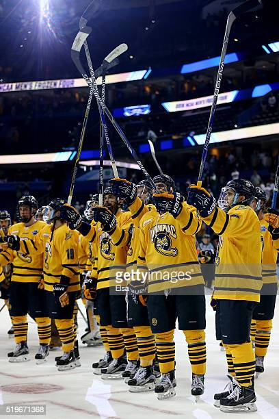The Quinnipiac Bobcats celebrate the win over the Boston College Eagles during semifinals of the 2016 NCAA Division I Men's Hockey Championships at...