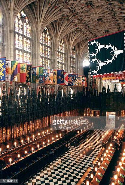 The Quire In Stgeorge's Chapel Above The Garter Stalls Hang The Banners Of The Knight Of The Garter Below Which Are Displayed Their Crests Helmets...