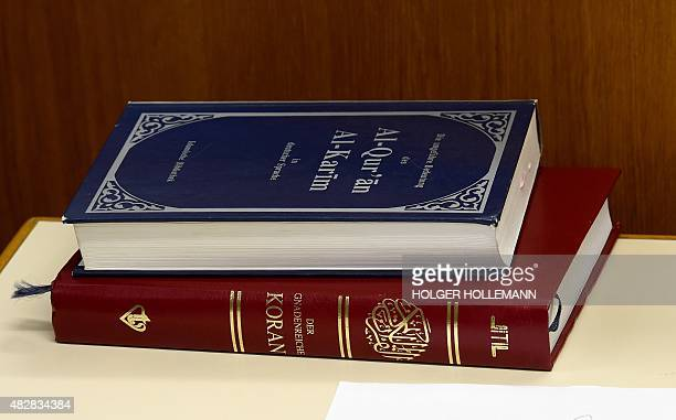 The Quran 's Arabic and German versions are pictured during the trial of two ISreturnees Ebrahim H B and Ayoub B on August 3 2015 in the courtroom in...