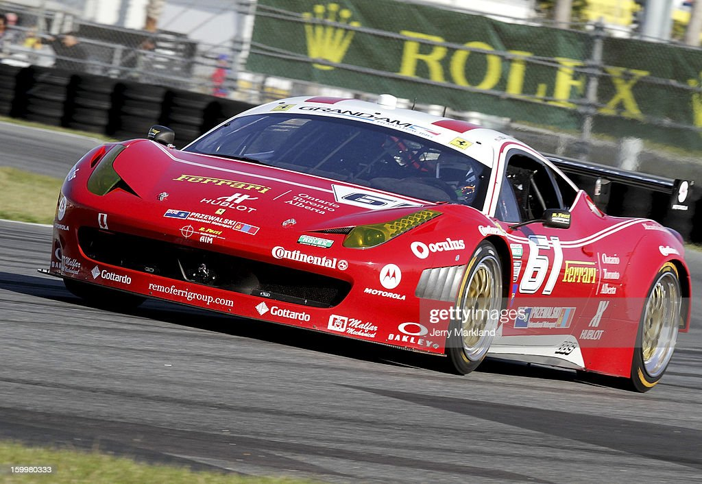 The #61 R. Ferri/Aim Motorsport Rcing with Ferrari, F458 driven by Max Papis, Jeff Segal, Toni Vilander and Giancario Fisichella drives on track during practice at Daytona International Speedway on January 24, 2013 in Daytona Beach, Florida.