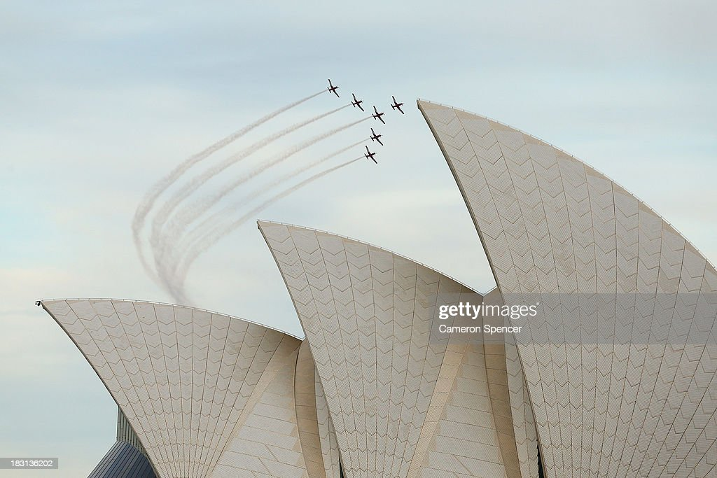 The RAAF 'Roulettes' fly past the Sydney Opera House during the International Fleet Review on October 5, 2013 in Sydney, Australia. Over 50 ships participate in the International Fleet Review at Sydney Harbour to commemorate the 100 year anniversary of the Royal Australian Navy's fleet arriving into Sydney. Prince Harry is an official guest of the Australian Government and will take part in the fleet review during his two-day visit to Australia.