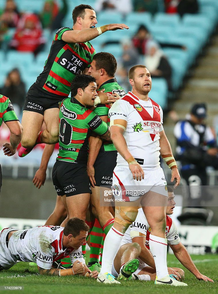 The Rabbioths celebrate with Sam Burgess of the Rabbitohs after he scored a try during the round 19 NRL match between the South Sydney Rabbitohs and the St George Illawarra Dragons at ANZ Stadium on July 22, 2013 in Sydney, Australia.