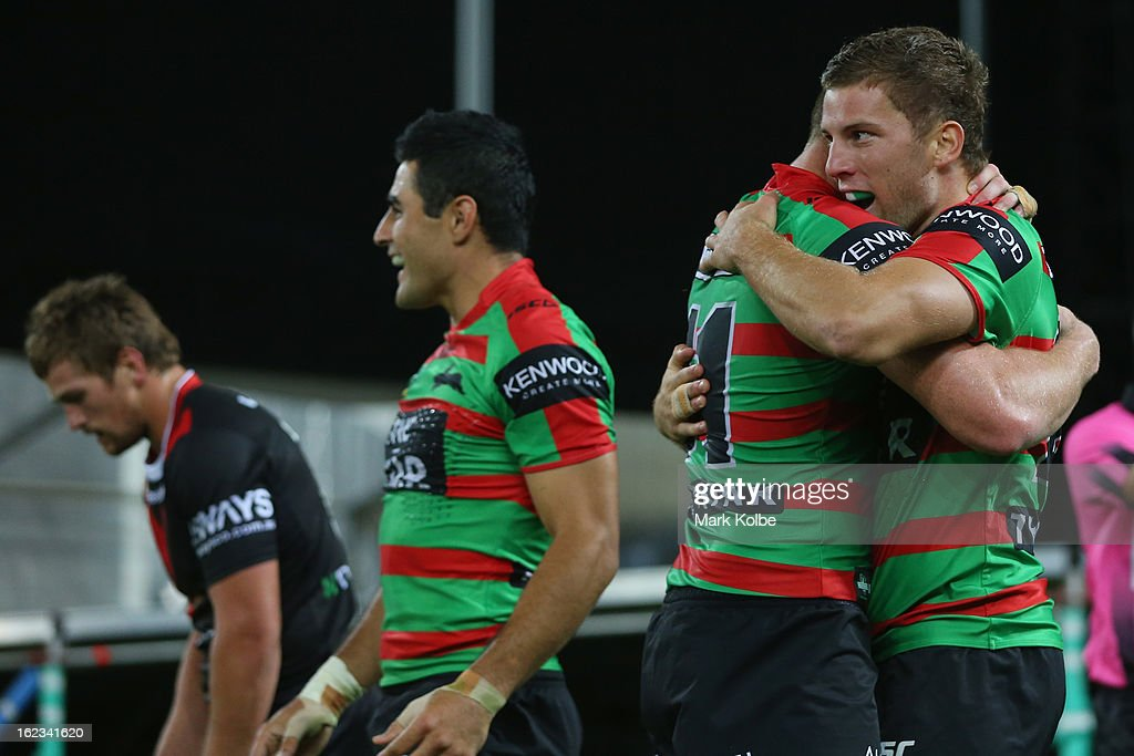 The Rabbitohs congratulate Mitchell Buckett of the Rabbitohs as he celebrates scoring a try during the NRL Charity Shield match between the South Sydney Rabbitohs and the St George Illawarra Dragons at ANZ Stadium on February 22, 2013 in Sydney, Australia.