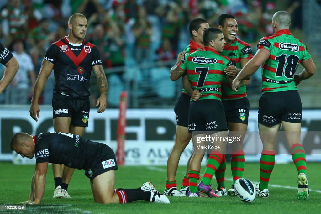 The Rabbitohs congratulate Nathan Peats of the Rabbitohs as he celebrates scoring a try during the NRL Charity Shield match between the South Sydney Rabbitohs and the St George Illawarra Dragons at ANZ Stadium on February 22, 2013 in Sydney, Australia.
