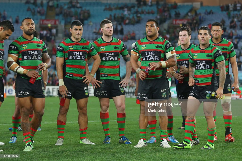The Rabbitohs look dejected after defeat during the round 26 NRL match between the South Sydney Rabbitohs and the Sydney Roosters at ANZ Stadium on September 6, 2013 in Sydney, Australia.