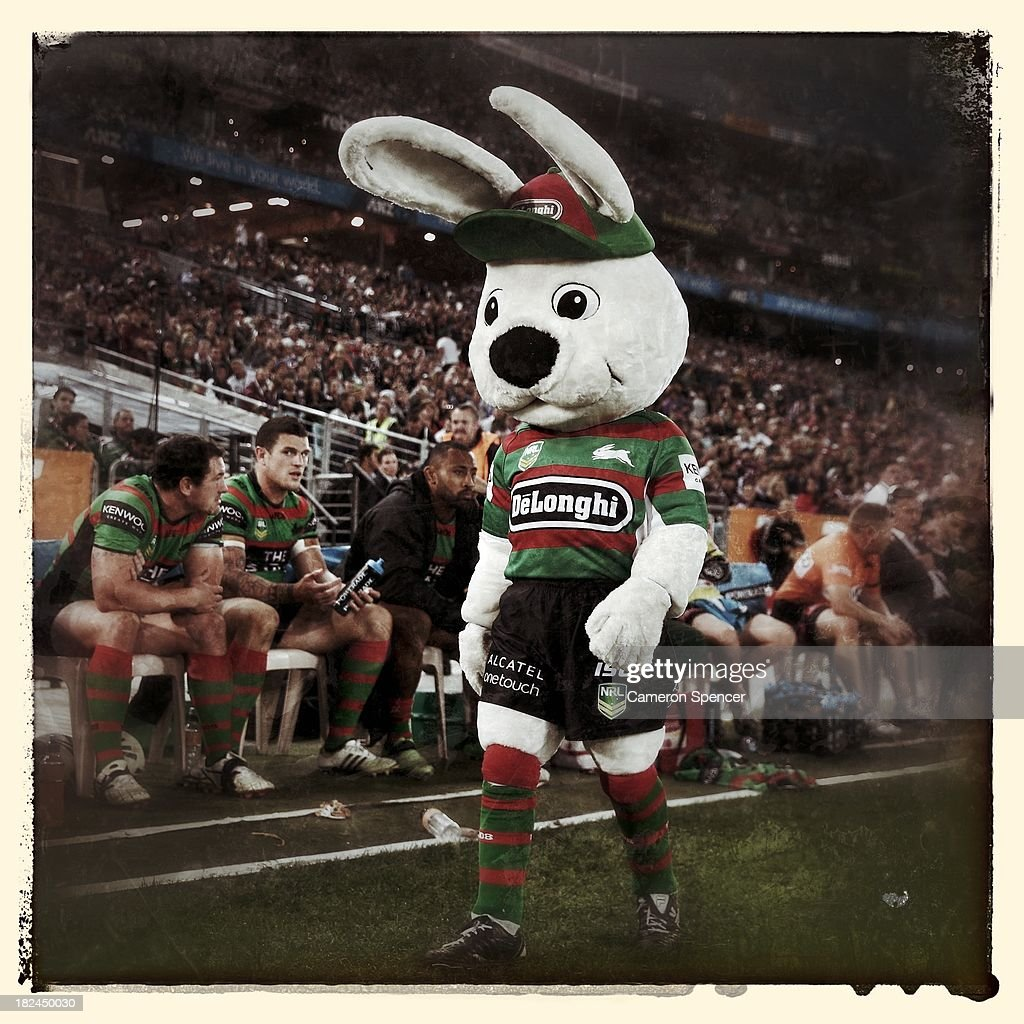 The Rabbitohs mascot walks past a dejected Souths bench during the NRL Preliminary Final match between the South Sydney Rabbitohs and the Manly Warringah Sea Eagles at ANZ Stadium on September 27, 2013 in Sydney, Australia.