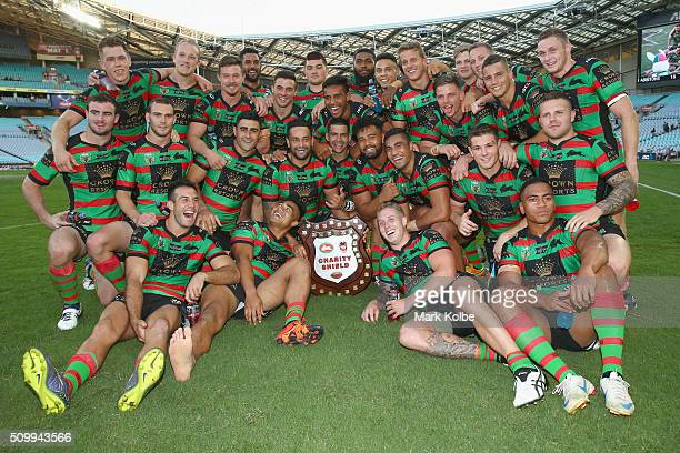 The Rabbitohs team celebrate with the Charity Shield after victory during the NRL Charity Shield match between the St George Illawarra Dragons and...