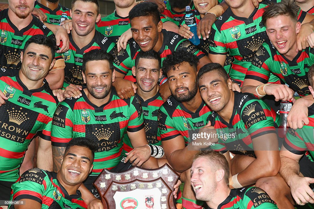 The Rabbitohs team celebrate with the Charity Shield after victory during the NRL Charity Shield match between the St George Illawarra Dragons and the South Sydney Rabbitohs at ANZ Stadium on February 13, 2016 in Sydney, Australia.