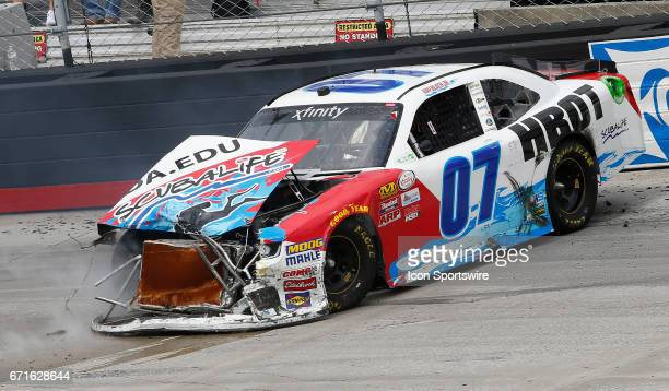 The race car of Ray Black II gets the nose clipped after spinning off Turn 4 during the Fitzgerald Glider Kits 300 NASCAR Xfinity Series race on...