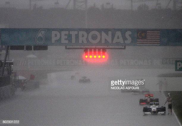The race is stopped as heavy rain falls during the Malaysian Grand Prix in Sepang on April 5 2009 Jenson Button won a chaotic Malaysian Grand Prix...