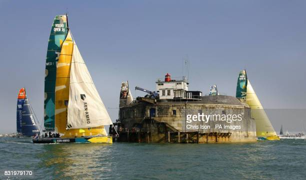 The race leader ABN Amro One unfurls a gennaker as the yachts competing in the Volvo Ocean Race pass Spit Sand Fort in the Solent soon after crossing...