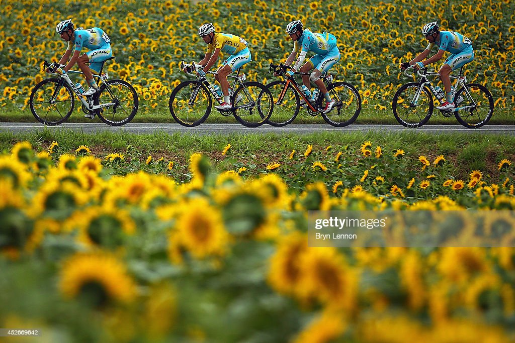 The race leader and yellow jersey <a gi-track='captionPersonalityLinkClicked' href=/galleries/search?phrase=Vincenzo+Nibali&family=editorial&specificpeople=770634 ng-click='$event.stopPropagation()'>Vincenzo Nibali</a> of Italy and Astana Pro Team rides flankled by his team-mates during the nineteenth stage of the 2014 Tour de France, a 208km stage between Maubourguet Pays du Val d'Adour and Bergerac, on July 25, 2014 in Bergerac, France.