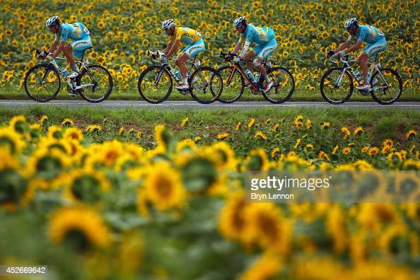 The race leader and yellow jersey Vincenzo Nibali of Italy and Astana Pro Team rides flankled by his teammates during the nineteenth stage of the...
