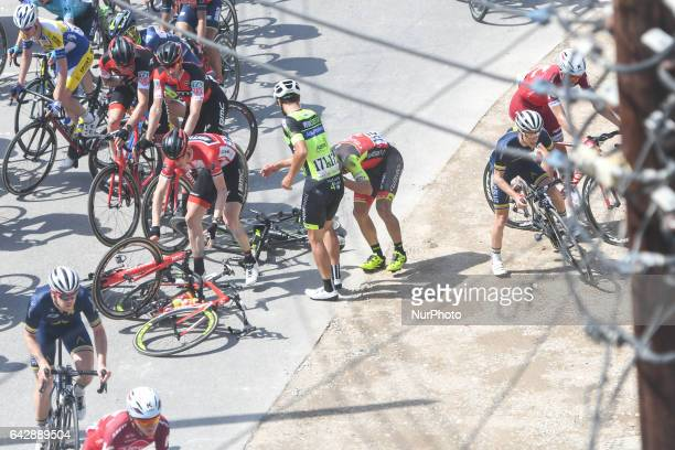 The race leader Ben HERMANS Roy JANS and Rafael ANDRIATO crash as the peloton of riders passes by the village of Ruwi on the outskirts of Muscat...