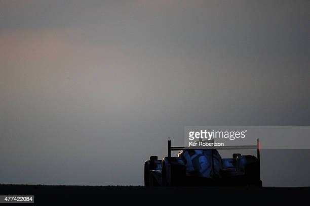 The race winning Porsche Team 919 Hybrid of Earl Bamber Nick Tandy and Nico Hulkenburg drives under the Dunlop Bridge at dawn during the Le Mans 24...