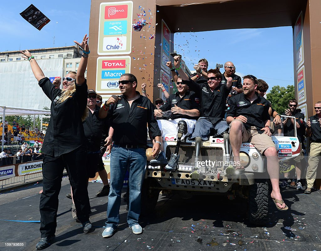 The Race2Recovery team celebrate during the podium presentations at the end of the 2013 Dakar Rally on January 20, 2013 in Santiago, Chile.