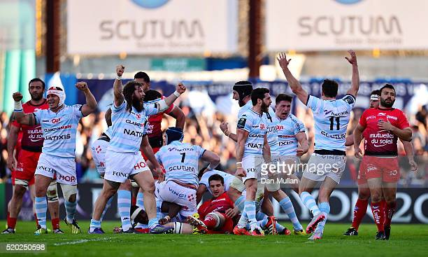 The Racing 92 players celebrate at the final whistle during the European Rugby Champions Cup Quarter Final between Racing 92 and RC Toulon at Stade...