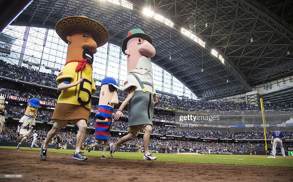 The racing sausages sprint to the finish line in the sixth inning of the Milwaukee Brewers and Colorado Rockies game on opening day at Miller Park on April 1, 2013 in Milwaukee, Wisconsin.