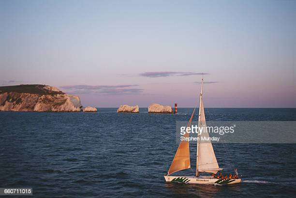 The racing yacht Heineken sails past the Needles to enter Southampton during the Whitbread round the World yacht race on 1 June 1994 off Cowes on the...