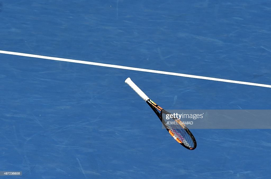 The racket of Simona Halep of Romania flies after she smashes it after losing a game against Sabine Lisicki of Germany during their 2015 US Open Women's singles round 4 match at the USTA Billie Jean King National Tennis Center in New York on September 7, 2015. Halep won 6-7(6), 7-5, 6-2.