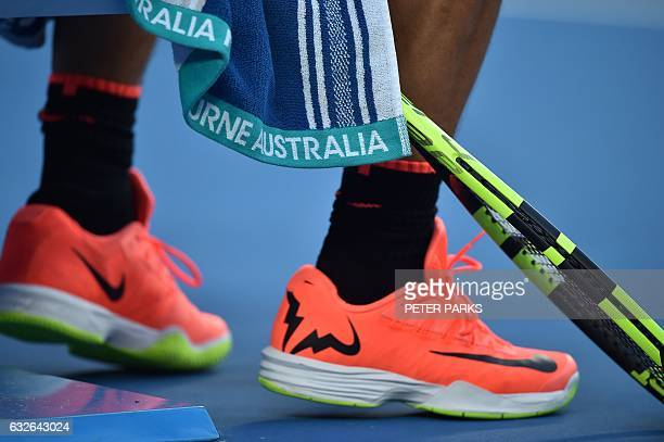 The racquet and shoes of Spain's Rafael Nadal are seen during his men's singles quarterfinal match against Canada's Milos Raonic on day ten of the...