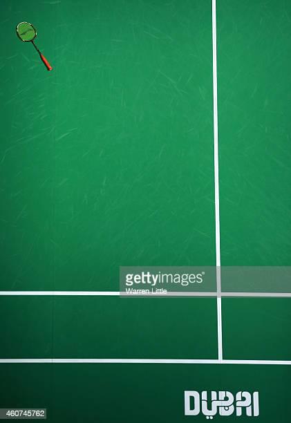 The racquet of Chen Long of China left on the court as he celebrates beating HansKristian Vittinghus of Denmark in the Final of the Men's Singles on...