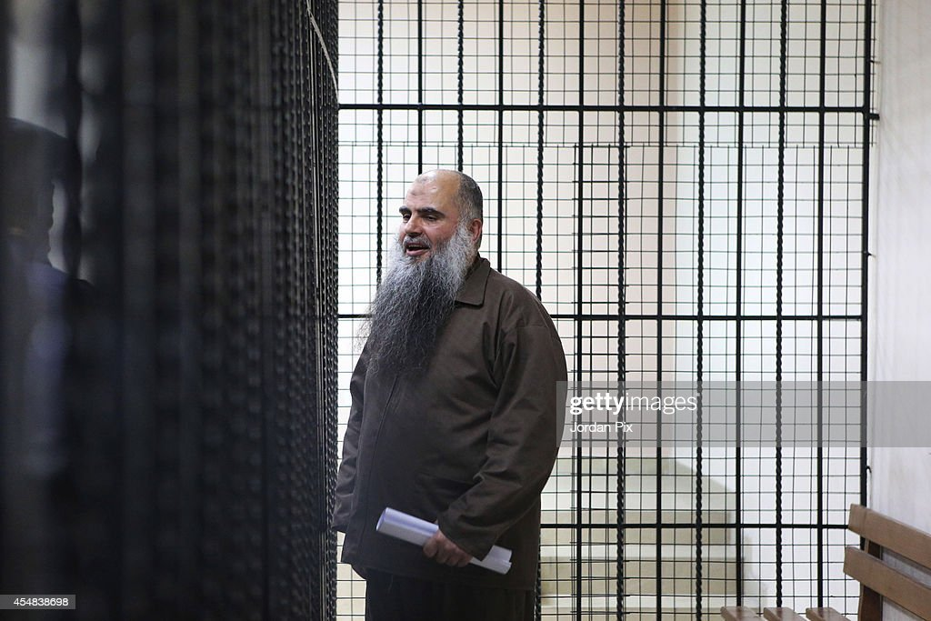 The radical cleric <a gi-track='captionPersonalityLinkClicked' href=/galleries/search?phrase=Abu+Qatada&family=editorial&specificpeople=643772 ng-click='$event.stopPropagation()'>Abu Qatada</a>, who was deported to Jordan from the UK, attends a hearing at the State Security Court on September 7, 2014 in Amman, Jordan. The court decided to delay its verdict for charges related to a terrorist plot in 2000 until September 24. <a gi-track='captionPersonalityLinkClicked' href=/galleries/search?phrase=Abu+Qatada&family=editorial&specificpeople=643772 ng-click='$event.stopPropagation()'>Abu Qatada</a>, whose real name is Omar Othman, is described as a senior al-Qaida figure who held close links to Osama bin Laden.