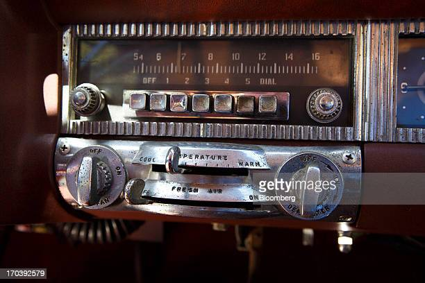 The radio and the temperature controls of a 1952 Chrysler Group LLC Town Country Wagon with the front end of a DeSoto grafted on is displayed near...