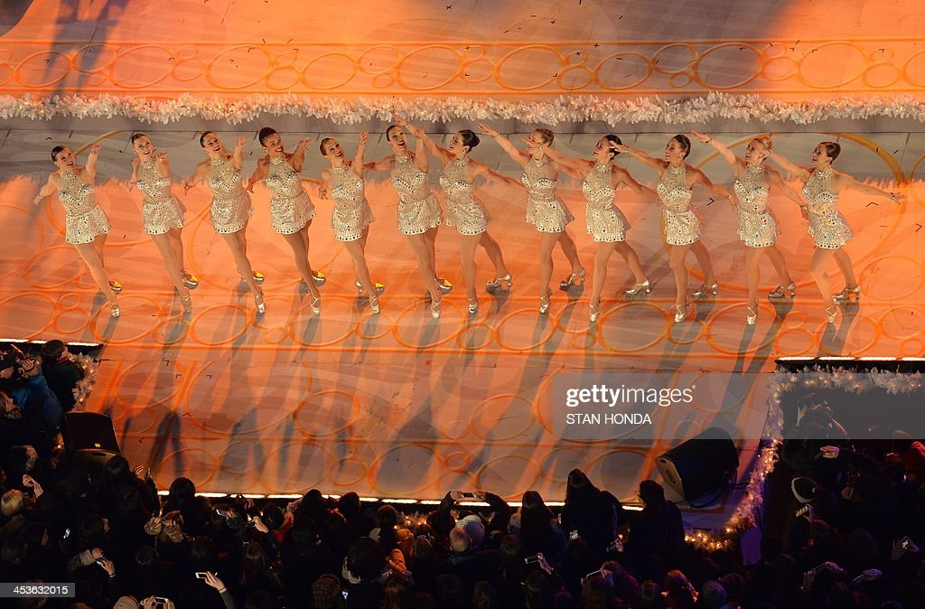 The Radio City Music Hall Rocketts perform before the Rockefeller Center Christmas Tree is lit December 4, 2013 in New York. AFP PHOTO/Stan HONDA